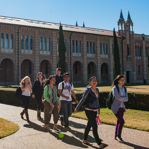 Undergraduate students walking in the quad